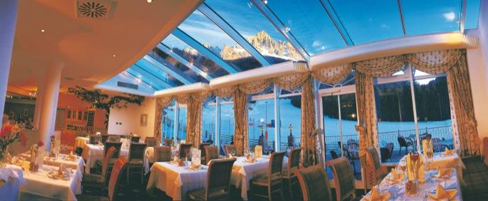 Ristorante panoramico all'Hotel Sonnalp di Obereggen. Gustare prelibatezze locali con vista Latemar